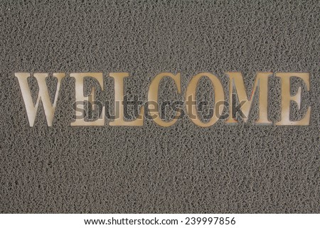 a straw hessian welcome mat matt isolated on a white background - stock photo