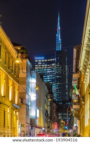 A street in Milan city center leading to the business district - stock photo