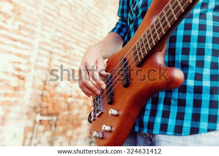 A street musician playing his guitar - stock photo