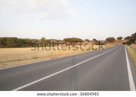 A street of asphalt on the middle of nowhere - stock photo