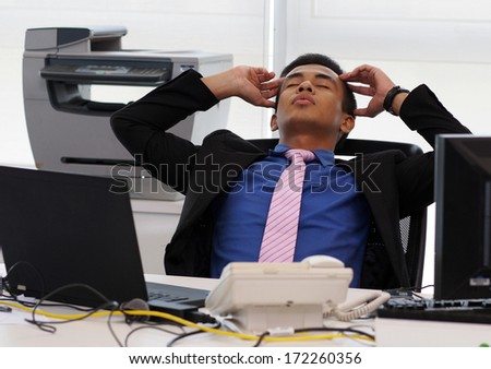 A stressful employee - stock photo