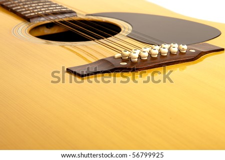 A 12 string acoustic guitar on a isolated background - stock photo