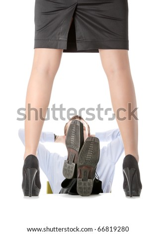 A stripped young business lady stending on desk, her boss watching her. Isolated on white - stock photo