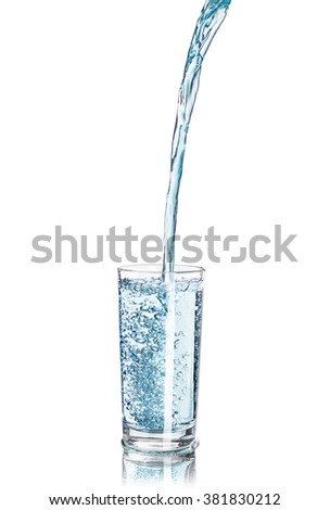 a strong pouring water pouring into a glass isolated on white background