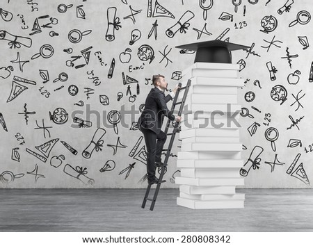 A student is climbing up to get university degree. Pile of books and a graduation hat as a prize.Concrete background with educational icons. - stock photo