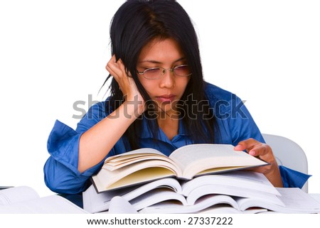 A student is very exhausted while there are still more books to learn. - stock photo