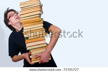 a student trying to keep a lot of their textbooks