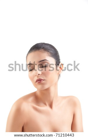 a studio beauty shot of a beautiful woman, with naked shoulders, on white background. her head is turned to the side and her eyes are shut. - stock photo