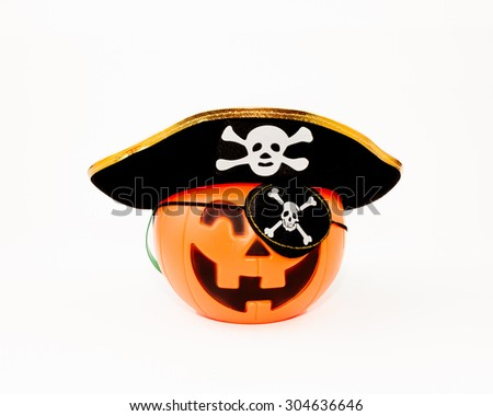 A studio isolated Jack O'lantern is decorated as a pirate for Halloween.