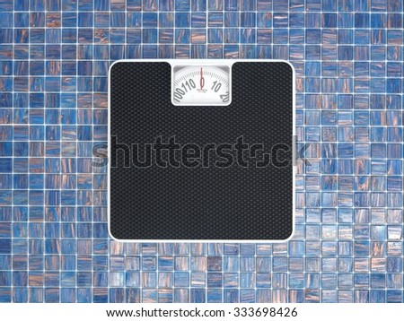 A studio photo of a set of body scales on tiles - stock photo