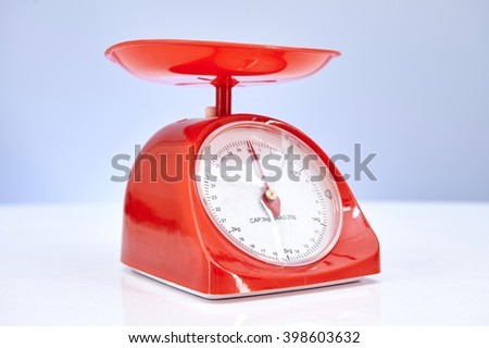 A studio photo of a set of kitchen food scales - stock photo