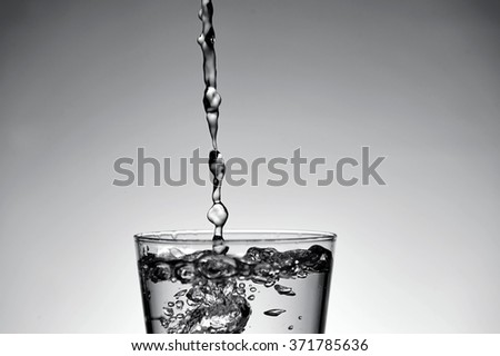 A studio photo of a tall water glass - stock photo