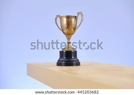 A studio photo of a vintage trophy - stock photo