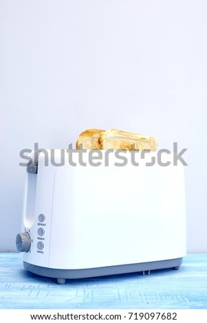A studio photo of a white toaster