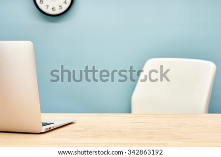 A studio photo of a workplace office desk - stock photo