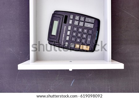 A studio photo of an electronic business calculator