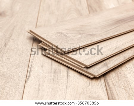 A studio photo of timber laminate flooring - stock photo