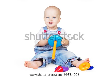 a studio portrait of a nice little child playing with color pyramid toy isolated on white background with clipping path