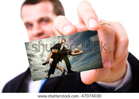 A studio shot of a businessman holding out a blank business card. Portrait young beautiful couple