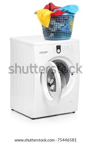 A studio shot of a laundry basket on a washing machine isolated on white background - stock photo