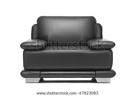A studio shot of a leather black armchair isolated on white background - stock photo
