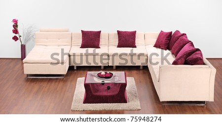 A studio shot of a modern white furniture decorated with pillows - stock photo