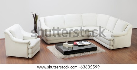 A studio shot of a white furniture, sofa and chair - stock photo