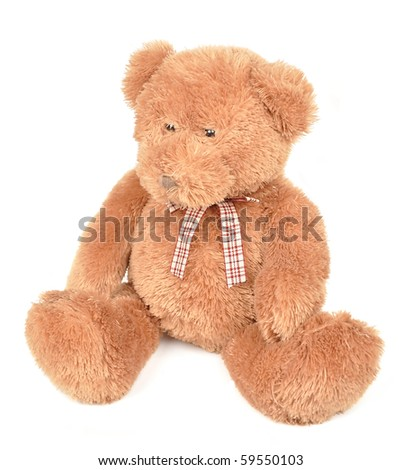A stuffed brown teddy bear is on a white background with a bow. Use it for a childhood or toy concept. - stock photo