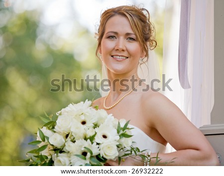 A Stunning Bride Holding Her Beautiful Bouquet - stock photo