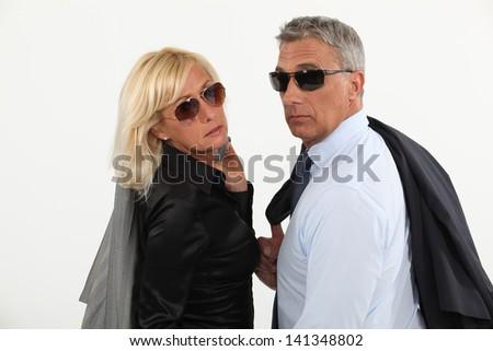 A stylish businesspeople couple. - stock photo