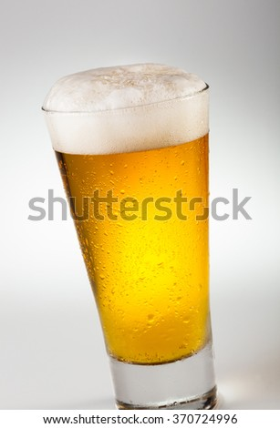 A stylish glass of wheat beer