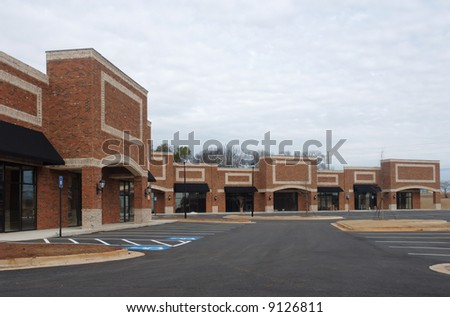 A suburban shopping center in the final stages of constructon.