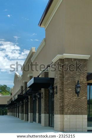 A suburban shopping center under construction - stock photo