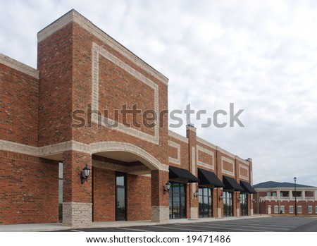 A suburban shopping center under construction (with no tenants). - stock photo