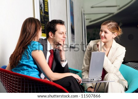 a successful business team is working on a table with a laptop - stock photo