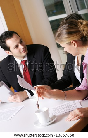 a successful business team with a document on a table - stock photo