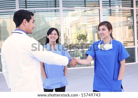 A successful medical team meeting outside hospital building - stock photo