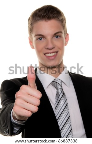 A successful young man holds up thumb