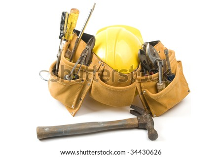 a suede leather contractor's construction man's tool belt with assorted tools and a yellow protective hard hat helmet - stock photo