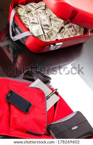 A Suitcase with lots of dollars, ready for business  - stock photo
