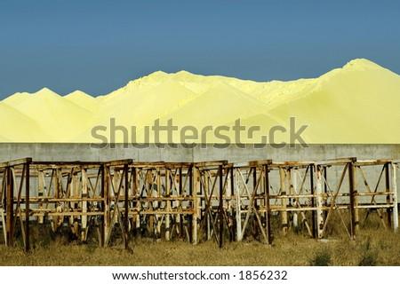 A sulfur storage area. - stock photo