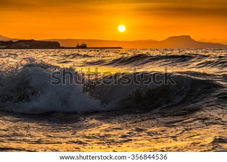 A summer beach in Greece, on a hot day - stock photo