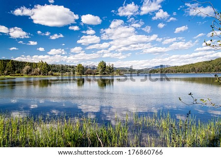 A summer day at a pristine, back-country lake in the Grand Tetons of Wyoming - stock photo