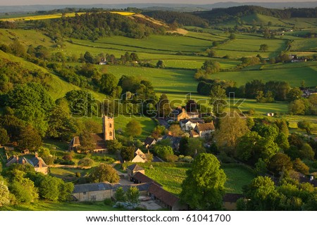 A summer evening view down onto the village of Corton Denham, Somerset, UK - stock photo