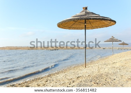 A sun shade made of reed at the lake Neusiedl, Burgenland.