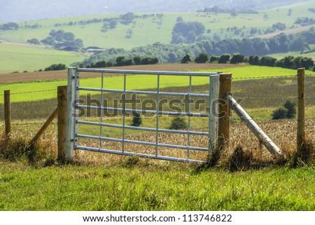 a sunlit gate - stock photo