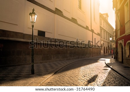 A sunlit street in Prague