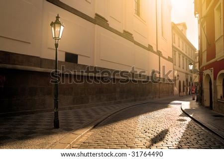 A sunlit street in Prague - stock photo