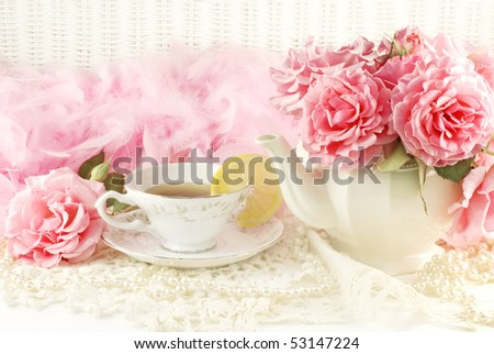 A sunny morning ladies breakfast tea with a teapot of fresh pink garden roses - stock photo