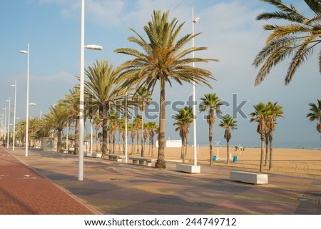 A sunny morning on Gandia beach promenade - stock photo